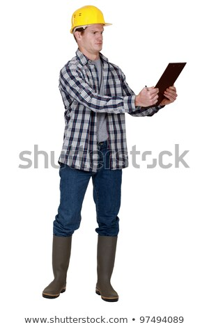 Incredulous tradesman looking at a clipboard Stock photo © photography33