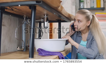 plumber sitting in front of sink stock photo © photography33