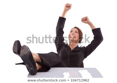 Nyugodt nyerő üzletasszony ül lábak asztal Stock fotó © feedough