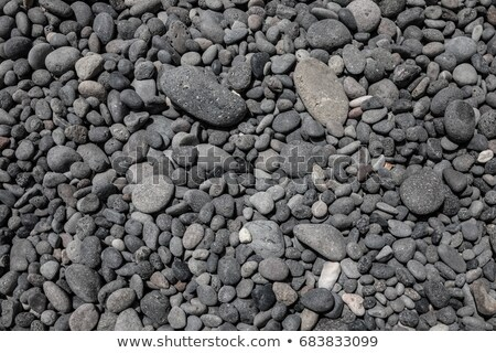 black gray volcanic lava rolling stones texture Stock photo © lunamarina