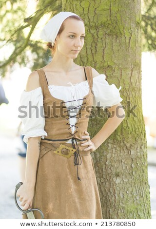 beautiful blonde woman in masquerade pirate costume stock photo © pilgrimego