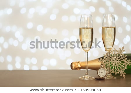 Champagne bottle, glasses and gift Stock photo © karandaev