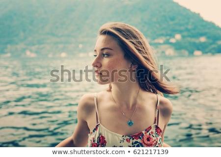 Csinos lány utazó hajó tenger nő Stock fotó © OleksandrO