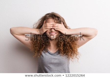 Peek a boo brunette. Stock photo © lithian