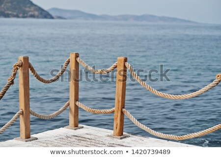 Wooden Dock and Banister on the Sea Stock photo © grivet