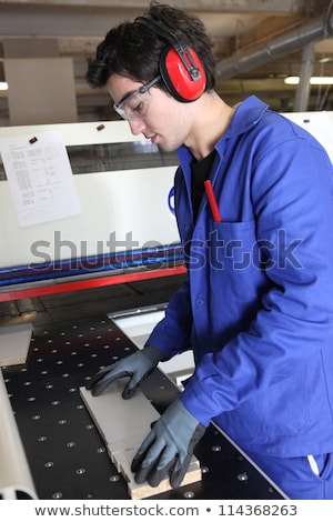 Fabrieksarbeider oor gebouw hout werk Stockfoto © photography33