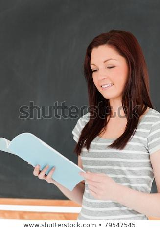 ストックフォト: かわいい · 女性 · 読む · ノート · 黒板 · 教室