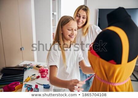 Young blond lady measuring her waist in a studio stock photo © wavebreak_media