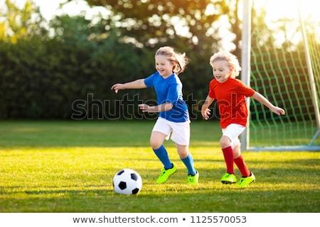 joven · balón · de · fútbol · pie · vertical · foto · blanco - foto stock © val_th
