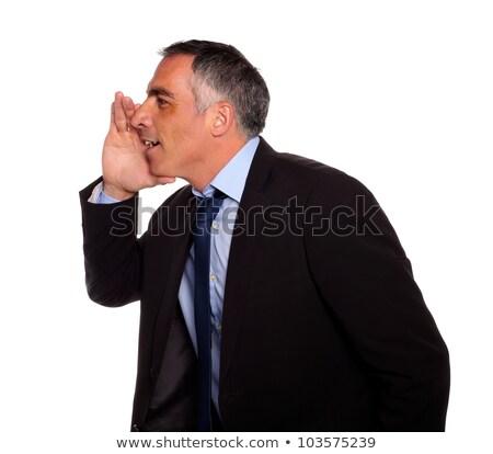 Hispanic senior businessman whispering stock photo © pablocalvog