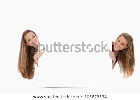 Portrait deux cheveux longs élèves pointant derrière Photo stock © wavebreak_media