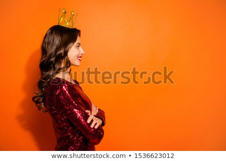 Glamorous woman in red dress having arm crossed Stock photo © wavebreak_media