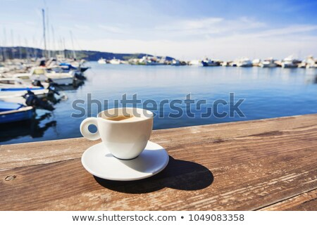 Coffee mug on wood table by harbor Stock photo © backyardproductions
