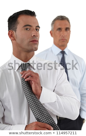 businessman adjusting tie in front of colleague stock photo © photography33