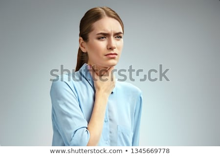 Sick young woman with pain throat on blue shirt Stock photo © pablocalvog