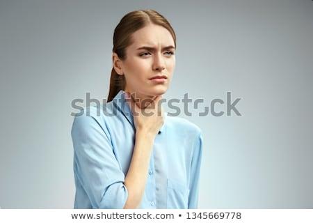 Chorych młoda kobieta ból gardło niebieski shirt Zdjęcia stock © pablocalvog