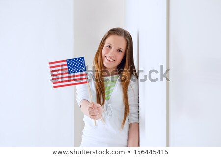 Portrait of a lovely young woman with United State's flag smilin Stock photo © HASLOO