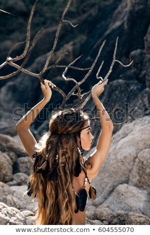 Hippie mujer posando dorado campo puesta de sol Foto stock © Witthaya