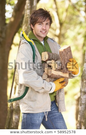 Man Outdoors In Autumn Woodland Gathering Logs Stock photo © monkey_business