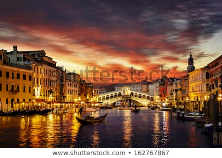 Gondolas floating in the Grand Canal at sunset Stock photo © vwalakte