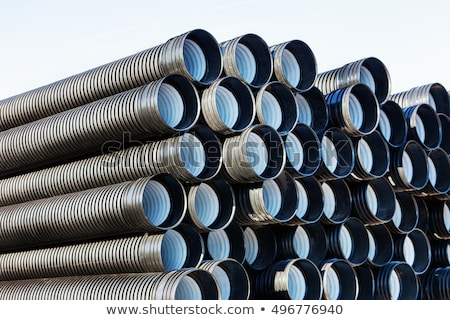 Rolls of plastic pipes in a warehouse yard Stock photo © juniart