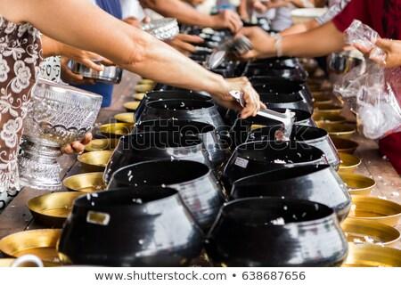hands worship a part of rice offering stock photo © nalinratphi
