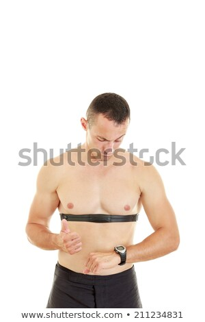 Man measuring heart beat and pulse with chest strap Stock photo © feelphotoart
