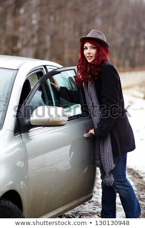 Woman entering her car in winter Stock photo © HASLOO