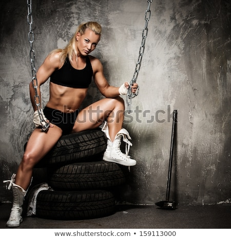 Muscular bodybuilder woman holding chains Stock photo © Nejron