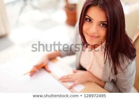 Piękna młodych architekta techniczne rysunki kobieta Zdjęcia stock © deandrobot