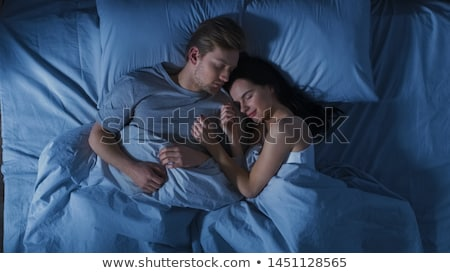loving couple sleeping in bed stock photo © andreypopov