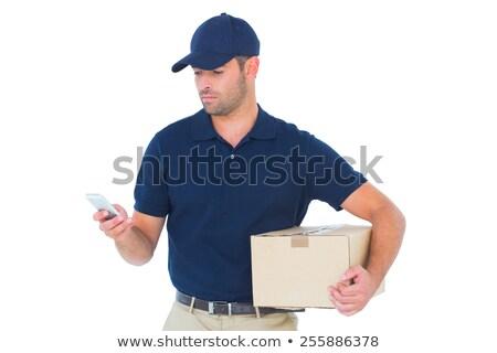 Téléphone portable livraison de colis homme paquet Photo stock © wavebreak_media