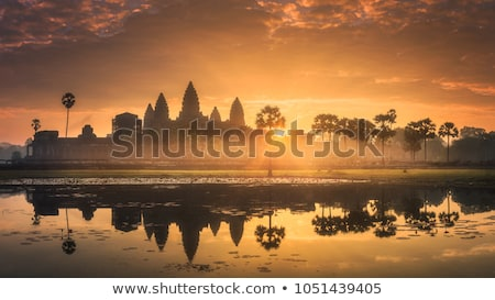Angkor Wat piscina pôr do sol edifício viajar pedra Foto stock © goinyk