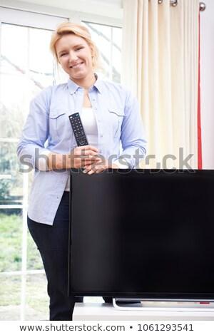 Retrato orgulhoso mulher novo televisão casa Foto stock © HighwayStarz