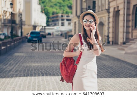 beautiful woman in red dress talks on mobile phone Stock photo © stryjek