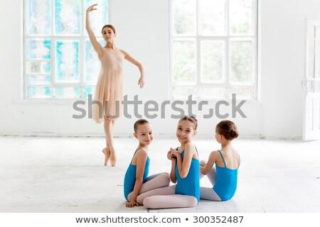Three little ballerinas dancing with personal ballet teacher in dance studio Stock photo © master1305
