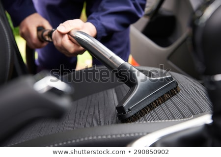 Man Vacuuming Car Seat With Vacuum Cleaner Stock photo © AndreyPopov