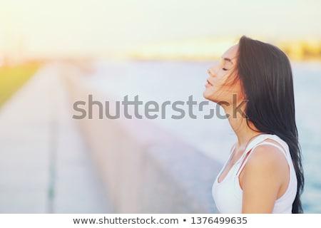 Güzel kız gözleri kapalı güzel genç kadın dokunmak yüz Stok fotoğraf © svetography