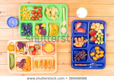 Three kids lunch trays with fruit Stock photo © ozgur