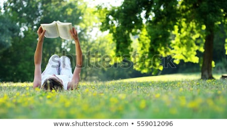 woman with dog reading book in autumn park stock photo © kzenon