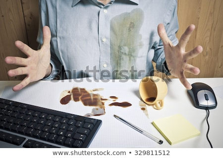 Coffee Spilled On A Shirt stock photo © watsonimages