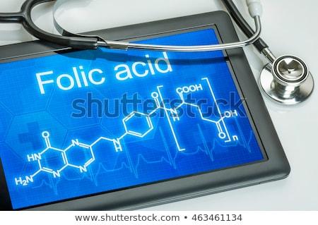 tablet with the chemical formula of folic acid stock photo © zerbor
