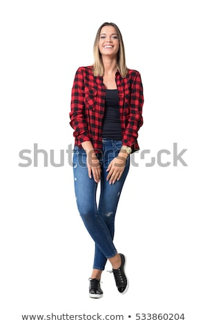 portrait of cheerful attractive young woman in plaid shirt stock photo © deandrobot
