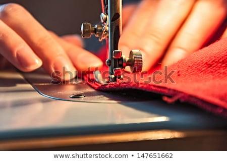 Woman tailor working on sewing machine. Hands. close up. Tailori stock photo © Yatsenko
