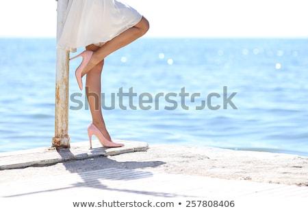 oldalnézet · lábak · nő · tengerpart · sétál · tenger - stock fotó © deandrobot