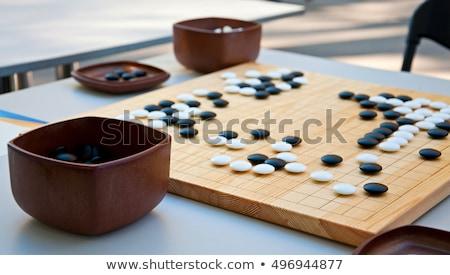 játék · tábla · feketefehér · kövek · kő · fekete - stock fotó © raywoo