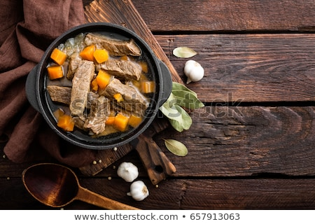 Delicious braised beef meat in broth with vegetables, goulash Stock photo © yelenayemchuk