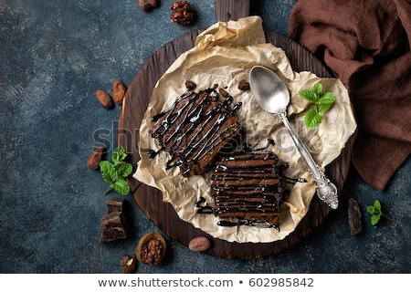 Stock photo: Chocolate brownie cake, dessert with nuts on dark background, directly above, flat lay