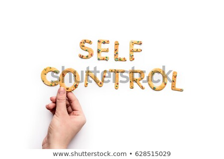Top view of self control lettering made from sweets isolated on white, healthy living concept Stock photo © LightFieldStudios
