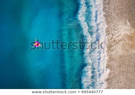 verão · mulher · água · flutuante · colchão · relaxar - foto stock © denbelitsky